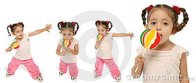 Toddler holding a lollipop wit