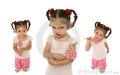 Toddler holding a lollypop wit