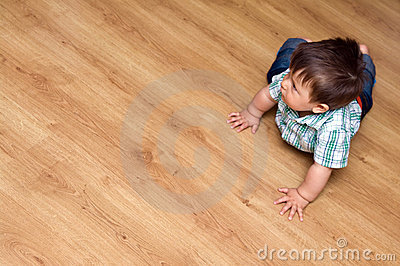 Toddler on laminate floor