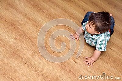 Toddler on laminate floor