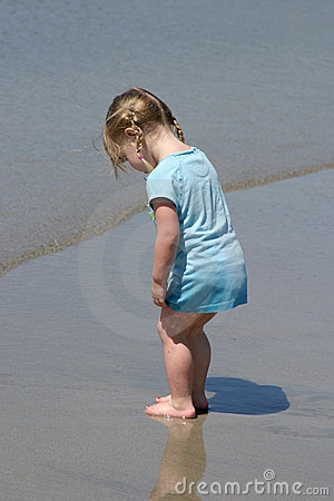 Toddler Looking at sand.