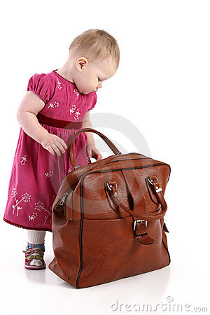Toddler opens an old travel bag