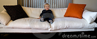 Toddler on an oversized sofa
