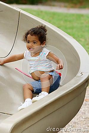 Toddler on playground slide