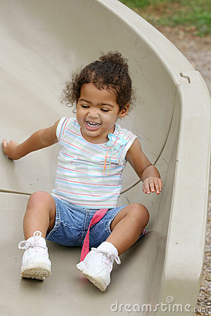 Toddler on playground slide