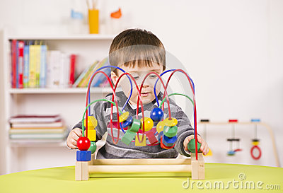 Toddler playing with a challenging toy