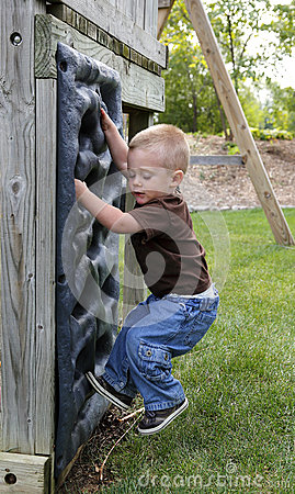 Toddler playing on climbing wall