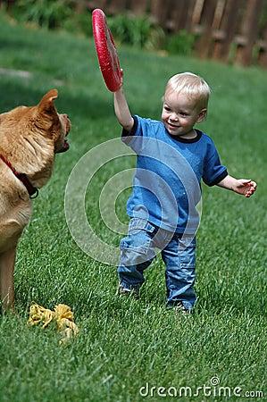 Toddler playing fetch game