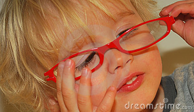 Toddler playing with glasses