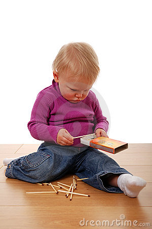 Toddler playing with matches