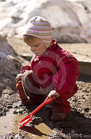 Toddler playing in mud