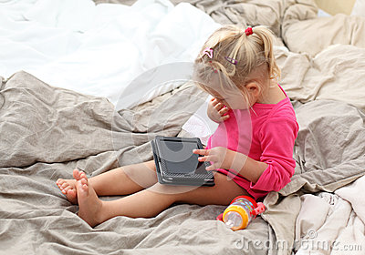 Toddler playing with a tablet pc