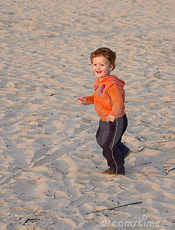 Toddler running beach