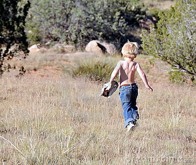 Toddler running outdoors