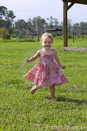Toddler running outdoors