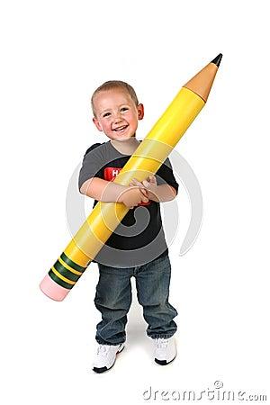 Free Toddler Schoolage Child Holding Large Pencil Royalty Free Stock Image - 9983756