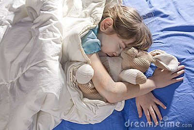Toddler sleeping with her hare