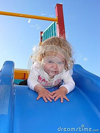 Toddler on slippery slide