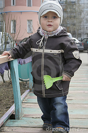 Toddler with toy spade