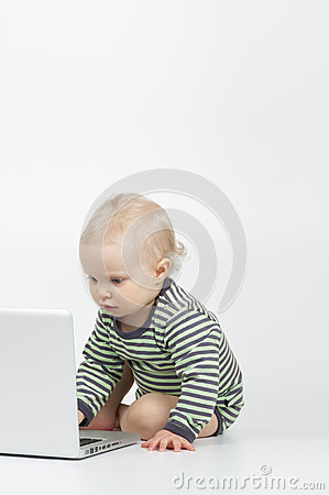 Toddler using laptop