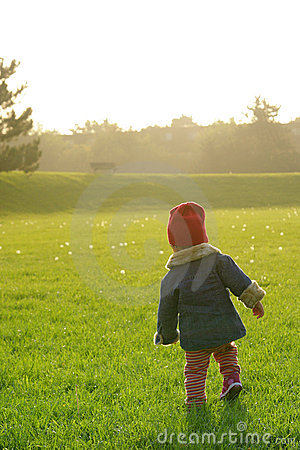 Toddler who is enjoying the sunset