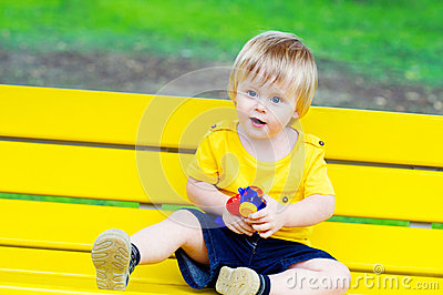 Toddler on the yellow bench