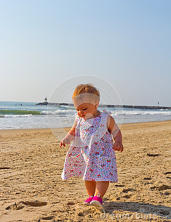 Toddling on beach