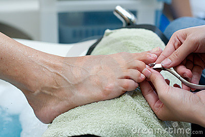 Toenail clipping by manicurist at salon