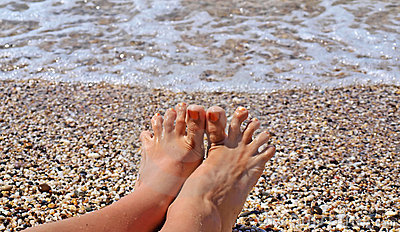 Toes on the coastline