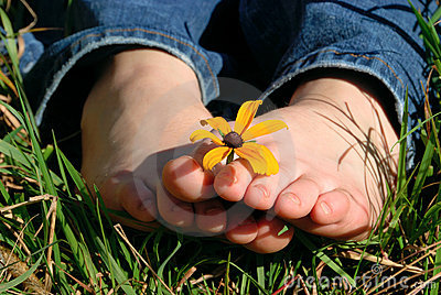 Toes holding flower