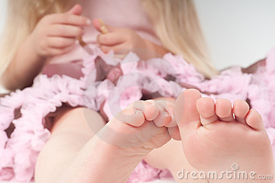 Toes of little girl in studio