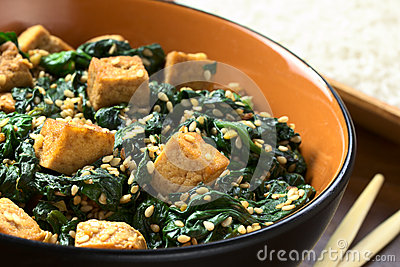 Tofu, spinach and sesame stir-fry fried with garlic and ginger, cooked ...