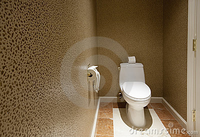 Toilet room with phone