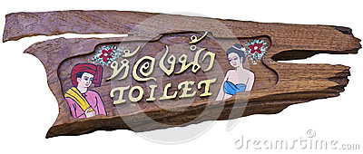 Toilet sign on wood