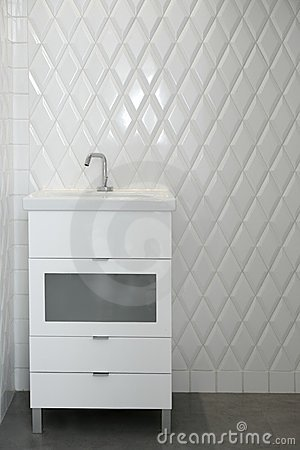 Toilet sink in a white room diamond shape tiles