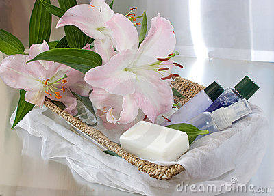 Toiletries in basket and pink lily