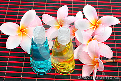 Toiletries with plumeria flower