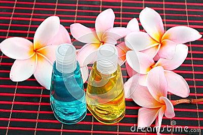 Toiletries with plumeria flower