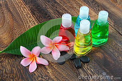 Toiletries with stones and plumeria flower