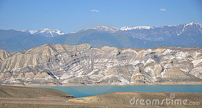 Toktogul water reservoir with striped mountains
