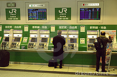 Tokyo JR station people buying tickets Editorial Stock Photo