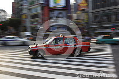 Tokyo taxi in Shibuya panned Editorial Photo