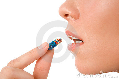 Tomando o comprimido