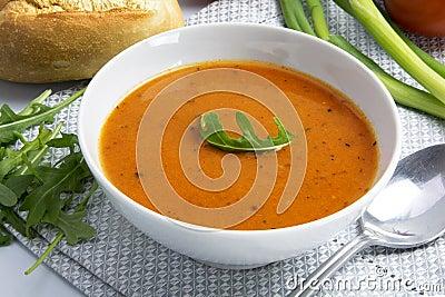 Tomato Cream Soup In A White Bowl With Arugula Garnish ... Cream Of Tomato Soup With Garnish