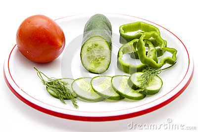 Tomato and cucumber slices with dill