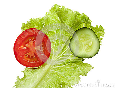 Tomato and cucumber slices over lettuce leaf