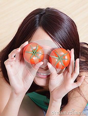 Free Tomato. Funny Girl Showing Tomatos Stock Photo - 29456910