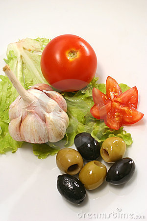 Tomato garlic and olives on lettuce