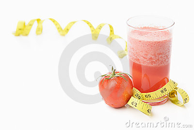 Tomato and juice with measuring tape