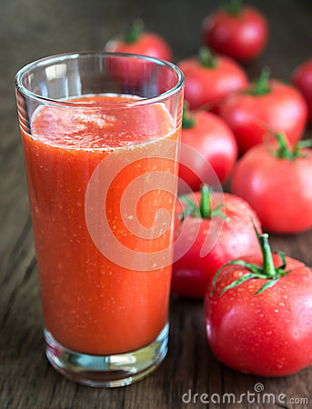 Free Tomato Juice With Fresh Tomatoes Stock Photo - 54688710